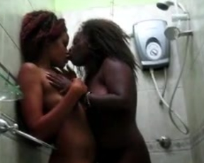Steaming hot ebony cuties cannot stop loving each other in the shower