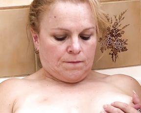 Dirty-minded mature slut finger fucks pussy in the shower until getting orgasm
