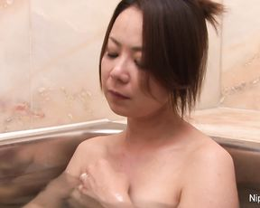 Lonely Asian girl masturbates in the shower teasing her naughty pussy nicely