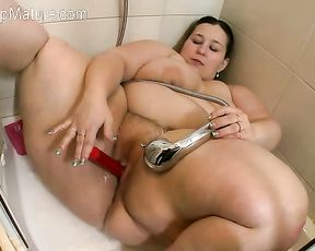 BBW slut masturbates with a stream of hot water and a pink dildo in the shower