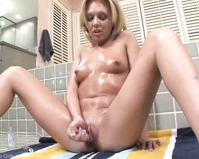 Blonde bitch masturbates in the shower using her dildo until she cums