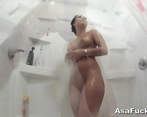 Asian slut is filmed while she masturbates and cums in the shower