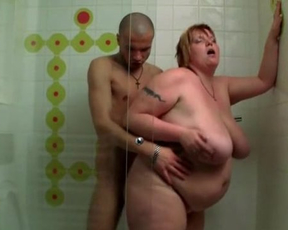 Fat mature bitch is fucked in the shower by a skinny motherfucker