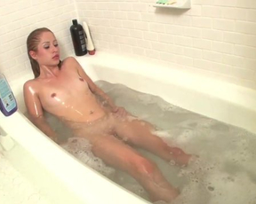 Petite babe taking a shower masturbates until she moans and cums